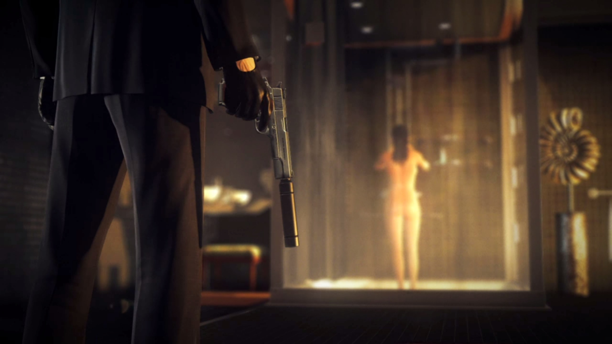 47 holding a silenced pistol in front of a woman in the shower