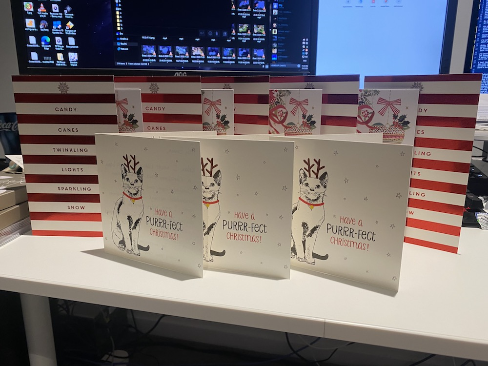 A collection of Christmas cards with hand-written, personalised messages
